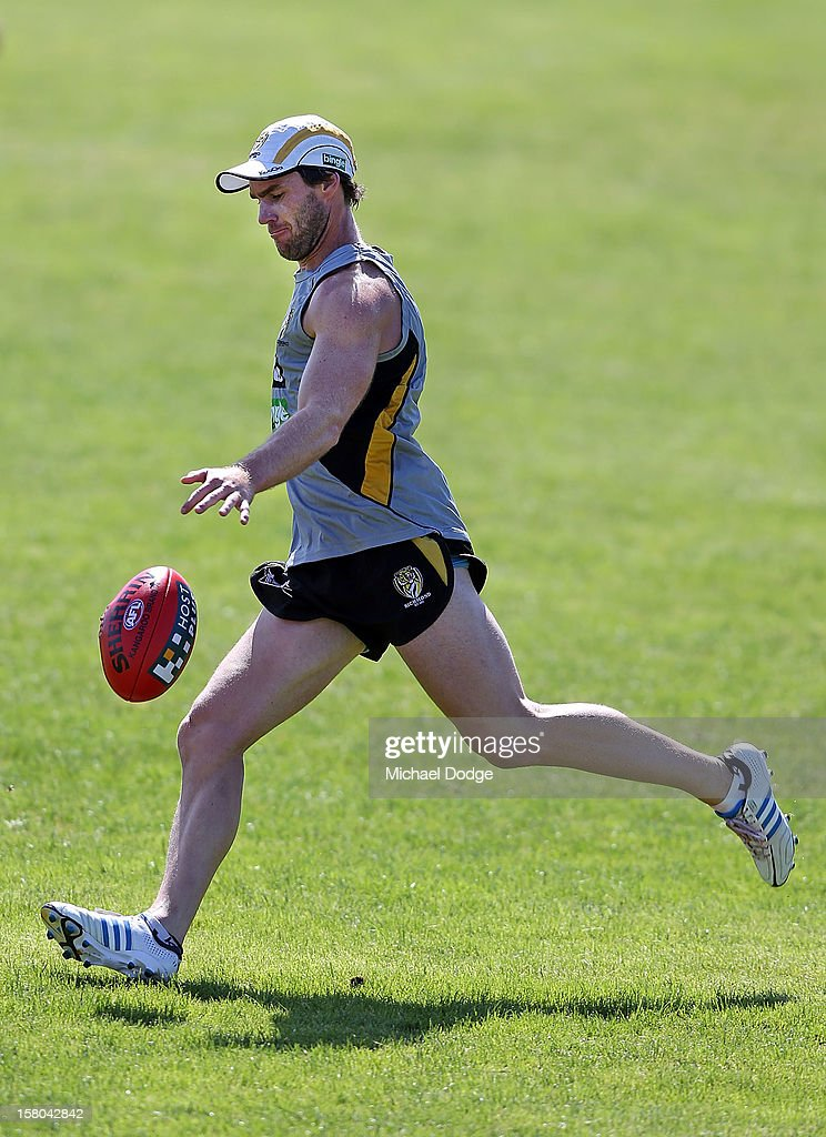 Chris Newman kicks the ball during a Richmond Tigers AFL training session at Trevor Barker Beach Oval on December 10, 2012 in Melbourne, Australia.