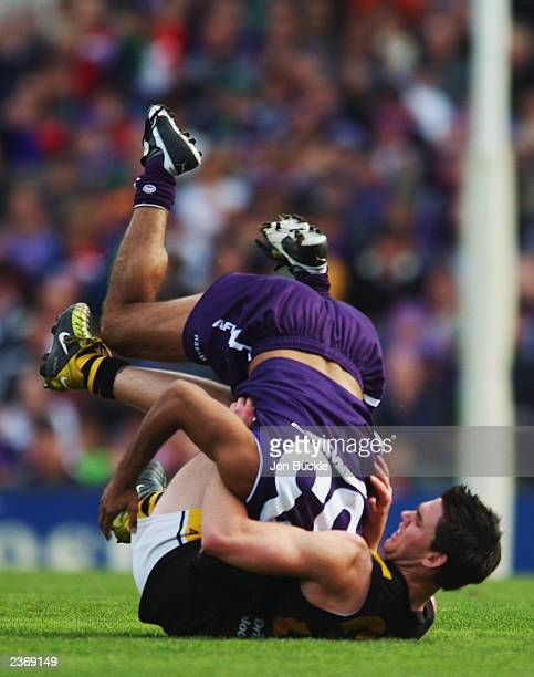 Chris Newman of the Tigers clashes with Jeff Farmer of the Dockers during the round 18 AFL match between the Fremantle Dockers and the Richmond...