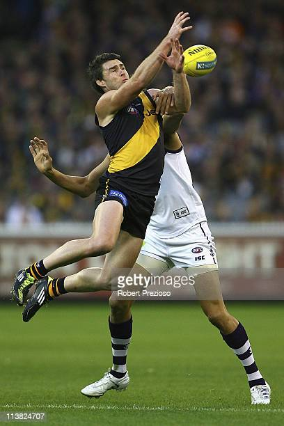 Chris Newman of the Tigers flies for a mark during the round seven AFL match between the Richmond Tigers and the fremantle Dockers at Melbourne...