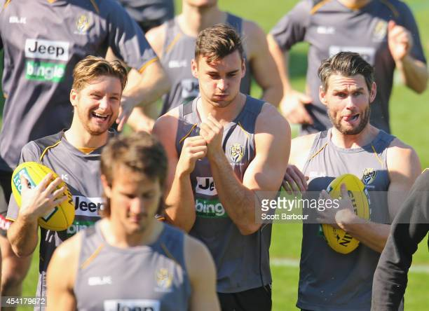 Chris Newman of the Tigers jokes around during a Richmond Tigers AFL training session at ME Bank Centre on August 26 2014 in Melbourne Australia