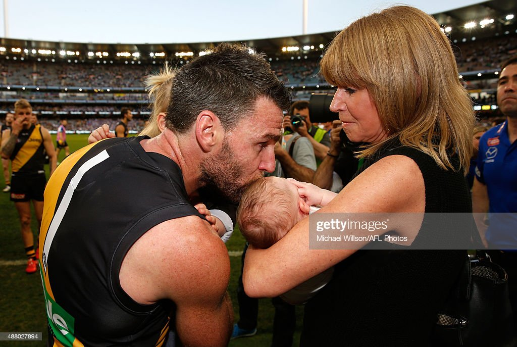 Chris Newman of the Tigers kisses family after his final match during the 2015 AFL First Elimination Final match between the Richmond Tigers and the North Melbourne Kangaroos at the Melbourne Cricket Ground, Melbourne, Australia on September 13, 2015.