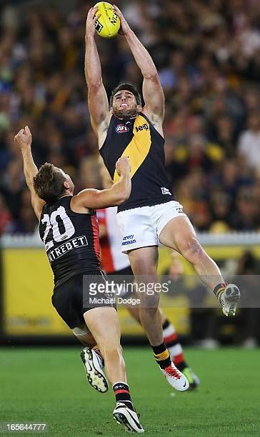Chris Newman of the Tigers marks the ball against David Armitage of the Saints during the round two AFL match between the St Kilda Saints and the...