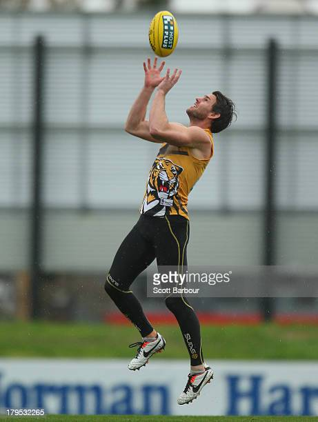 Chris Newman of the Tigers runs with the ball during a Richmond Tigers AFL training session at ME Bank Centre on September 5 2013 in Melbourne...