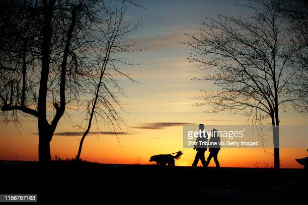 Chris Nichols and Wendy Smith walked their dog Odie along the shores of Lake Millie Lacs on the eve of the Minnesota fishing opener Friday May 8 2015...