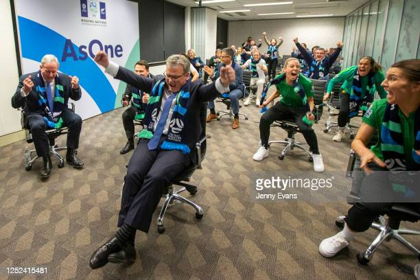 Chris Nikou, Chairman of Football Federation Australia along with officials and players react as FIFA announced Australia as the hosts to the 2023...