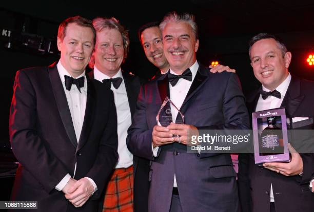 Chris Noth , winner of the Cigar Smoker Of The Year award, poses with Tom Parker Bowles, Ranald Macdonald and guests at The Vina Carmen Cigar Smoker...