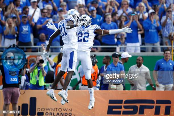 Chris Oats and Chris Westry of the Kentucky Wildcats celebrate against the Penn State Nittany Lions in the first quarter of the VRBO Citrus Bowl at...