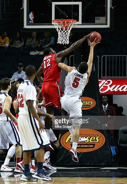 Chris Obekpa of the St John's Red Storm blocks the shot of Jalen Cannon of the St Francis Terriers during the Brooklyn Hoops Winter Festival on...