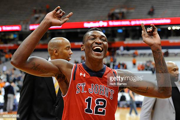 Chris Obekpa of the St John's Red Storm celebrates following the game against the Syracuse Orange at the Carrier Dome on December 6 2014 in Syracuse...