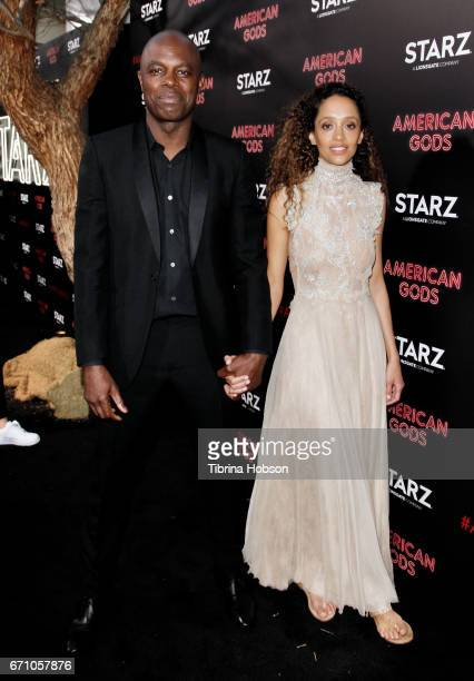 Chris Obi and Gloria Huwiler attend the premiere of Starz's 'American Gods' at ArcLight Cinemas Cinerama Dome on April 20, 2017 in Hollywood,...