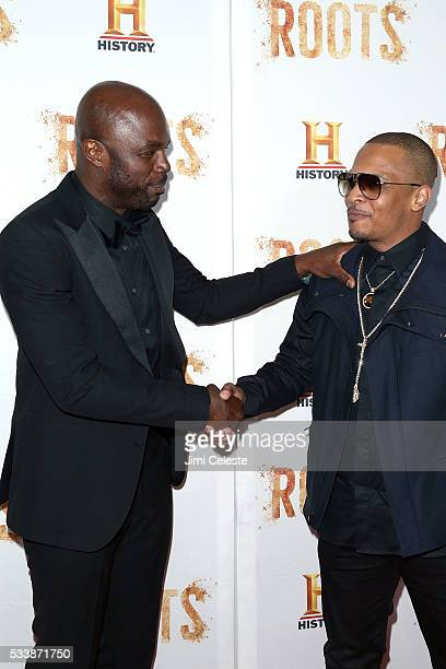"""Chris Obi and Tip """"T.I."""" Harris, attend as HISTORY presents night one of the epic event series """"Roots"""" at Alice Tully Hall on May 23, 2016 in New..."""