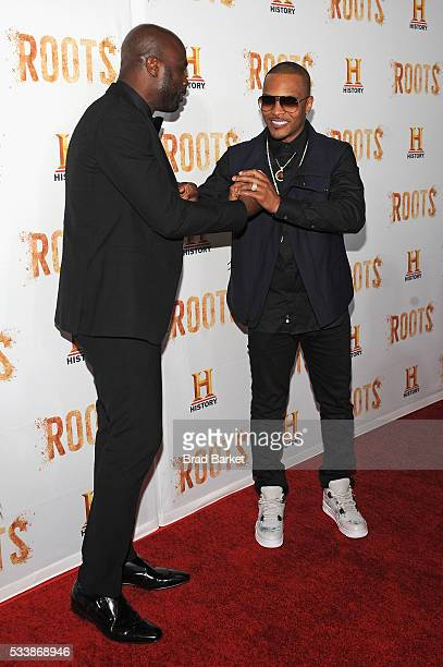 """Chris Obi and Tip """"T.I. Harris attend the premiere screening of """"Night One"""" of the four night epic event series, """"Roots,"""" hosted by HISTORY at Alice..."""