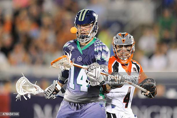 Chris O'Dougherty of the Denver Outlaws pops the ball form Drew Westervelt of the Chesapeake Bayhawks during a MLL lacrosse game at NavyMarine Corps...