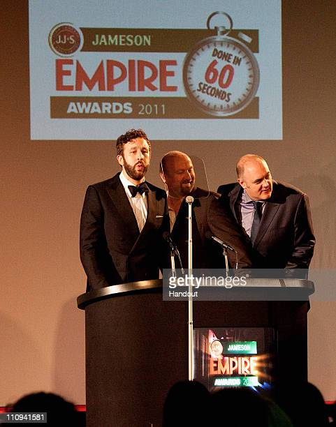 Chris O'Dowd and Neil Marshall who presented the Done in 60 Seconds award with host Dara O'Briain on stage during the Jameson Empire Awards at the...