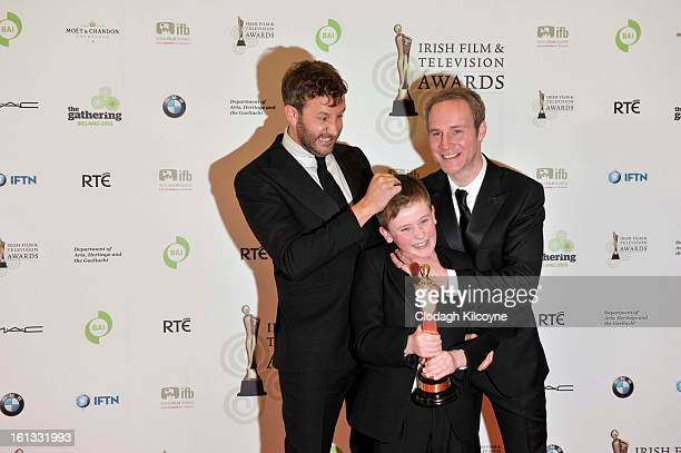 Chris O'Dowd David Rawle and Peter McDonald pose in the Press Room at the Irish Film and Television Awards at Convention Centre Dublin on February 9...