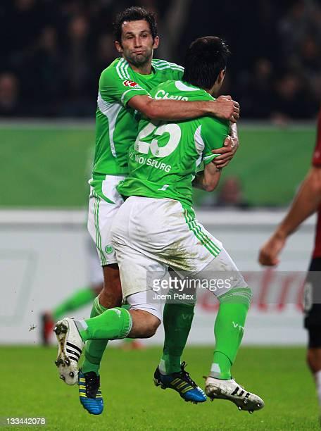 Chris of Wolfsburg celebrates with his team mate Hasan Salihamidzic after scoring his team's third goal during the Bundesliga match between VfL...