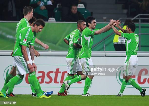 Chris of Wolfsburg celebrates with his team mate Josue after scoring his team's third goal during the Bundesliga match between VfL Wolfsburg and...