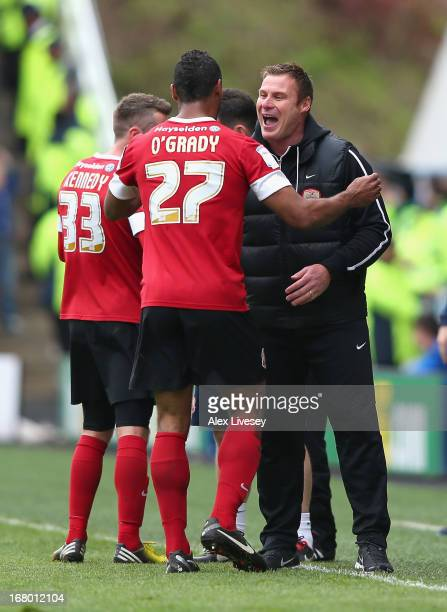 Chris O'Grady of Barnsley celebrates scoring the opening goal with Barnsley manager David Flitcroft during the npower Championship match between...