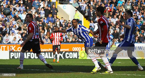 Chris O'Grady of Sheffield Wednesday looks on after his header beats Steve Simonsen of Sheffield United to score a goal during the npower League One...