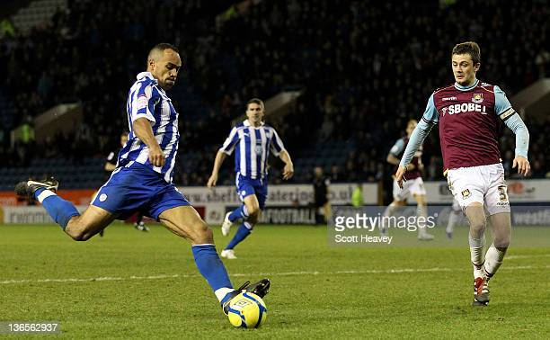 Chris O'Grady of Sheffield Wednesday scores the opening goal during the FA Cup Third Round match between Sheffield Wednesday and West Ham United at...