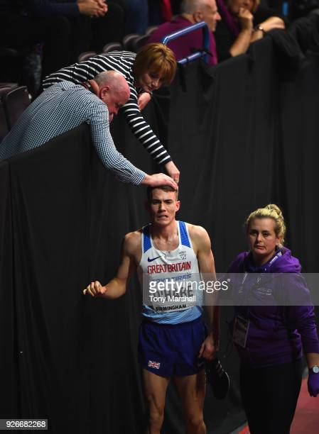Chris O'Hare is commiserated withafter finishing fifth in his heat of the Men's 1500m during Day Three of the IAAF World Indoor Championships at...