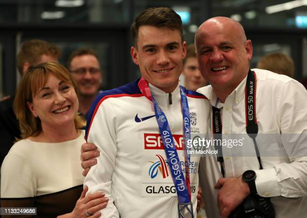 Chris O'Hare of Great Britain poses with his parents during the European Athletics Indoor Championships Day Two at the Emirates Arena on March 02...