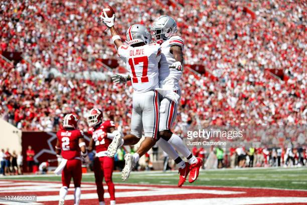 Chris Olave and Binjimen Victor of the Ohio State Buckeyes celebrate after a safety in the game against the Indiana Hoosiers at Memorial Stadium on...