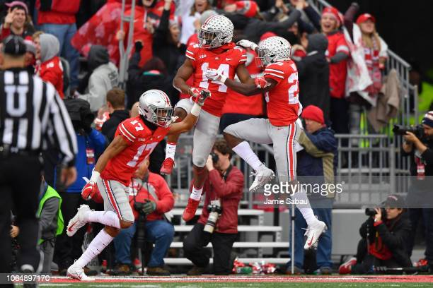 Chris Olave KJ Hill and Jahsen Wint of the Ohio State Buckeyes celebrate after Olave blocked a Michigan Wolverines punt in the third quarter and Ohio...