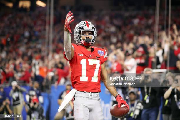 Chris Olave of the Ohio State Buckeyes celebrates his touchdown reception against the Clemson Tigers in the second half during the College Football...