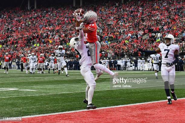 Chris Olave of the Ohio State Buckeyes makes the catch for a 28-yard touchdown pass over John Reid of the Penn State Nittany Lions in the fourth...