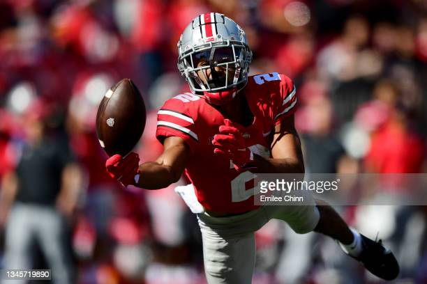 Chris Olave of the Ohio State Buckeyes reaches to try to catch a pass in the third quarter during a game against the Maryland Terrapins at Ohio...