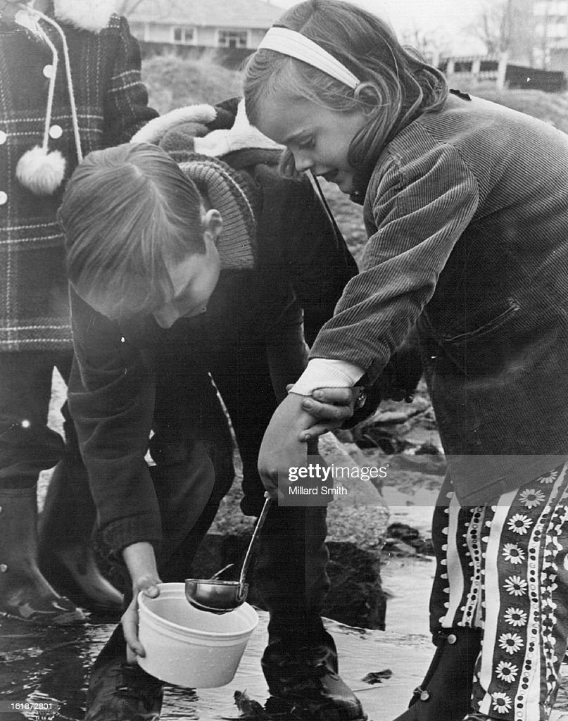 APR 18 1970, MAY 08 1970, MAY 13 1970; Chris O'Neal, 10, helps ***** Alison, 6, dip for water organi : News Photo