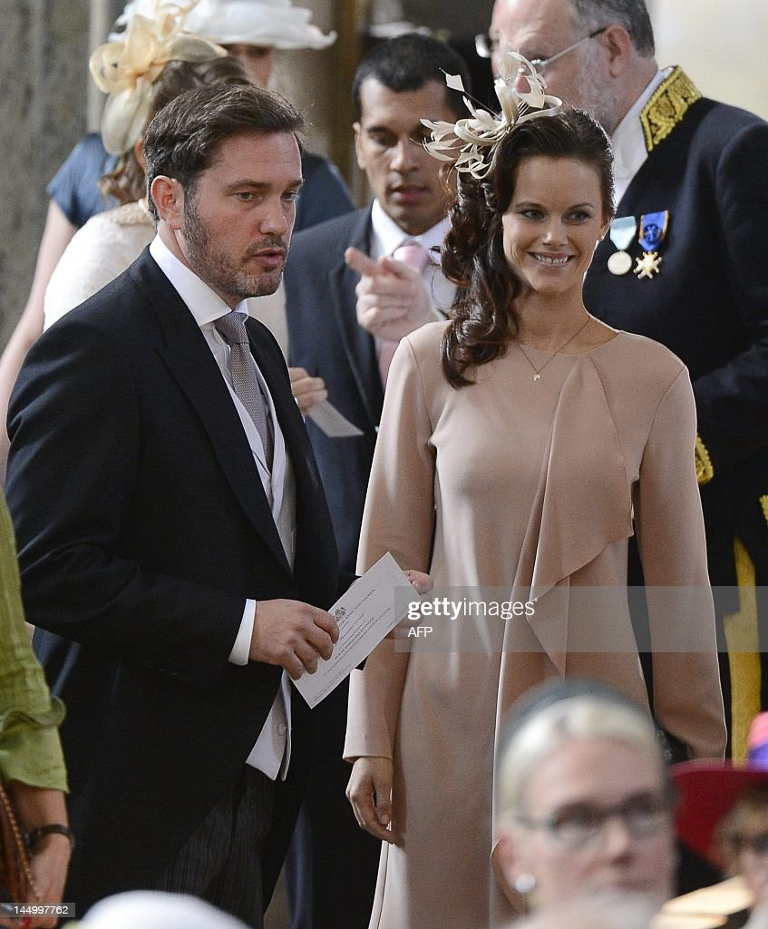 Chris O´Neill (L), boyfriend of Sweden's Princess Madeleine, and Sofia Hellqvist (R), girlfriend of Prince Carl Philip, arrive on May 22, 2012 for the christening of Princess Estelle of Sweden at the Royal Chapel in Stockholm. Princess Estelle, second in line to the throne after her mother Crown Princess Victoria, is the daughter of Prince Daniel of Sweden. AFP PHOTO / POOL / Claudio Bresciani