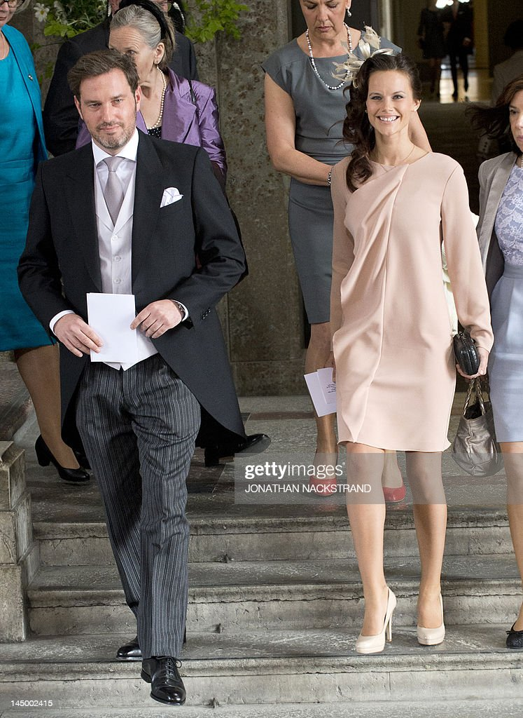 Chris O'Neill (L), boyfriend of Sweden's Princess Madeleine, and Sofia Hellqvist (R), girlfriend of Prince Carl Philip leave the Royal Chapel on May 22, 2012 after the christening of Princess Estelle of Sweden in Stockholm. Princess Estelle, second in line to the throne after her mother Crown Princess Victoria, is the daughter of Prince Daniel of Sweden.