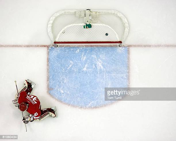 Chris Osgood of the Detroit Red Wings gives up a goal against the Dallas Stars during game two of the Western Conference Finals of the 2008 NHL...