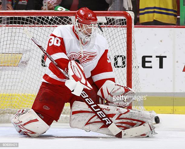 Chris Osgood of the Detroit Red Wings makes a save during their game against the Vancouver Canucks at General Motors Place on October 27 2009 in...
