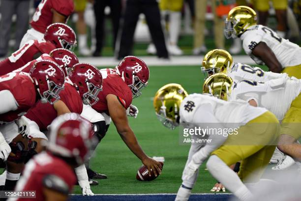 Chris Owens of the Alabama Crimson Tide sets the line during the College Football Playoff Semifinal at the Rose Bowl football game against the Notre...
