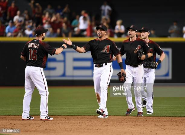 Chris Owings David Peralta AJ Pollock and Jeremy Hazelbaker of the Arizona Diamondbacks celebrate a 115 win against the Los Angeles Dodgers at Chase...