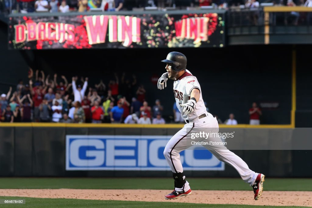 Chris Owings #16 of the Arizona Diamondbacks celebrates after hitting the game winning RBI single against the San Francisco Giants during the ninth inning of the MLB opening day game at Chase Field on April 2, 2017 in Phoenix, Arizona.