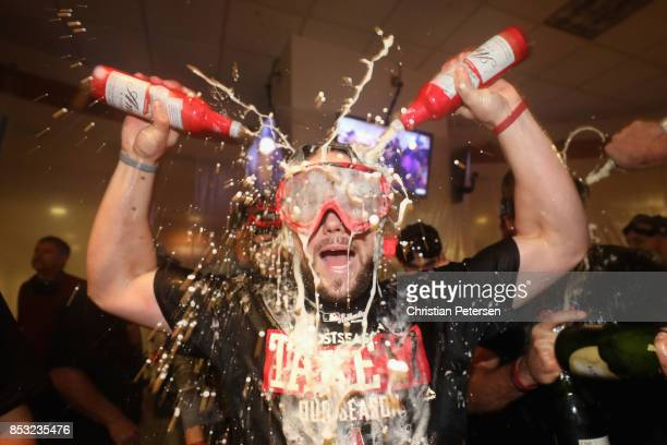 Chris Owings of the Arizona Diamondbacks celebrates in the clubhouse after defeating the Miami Marlins and clinching a post season birth following...