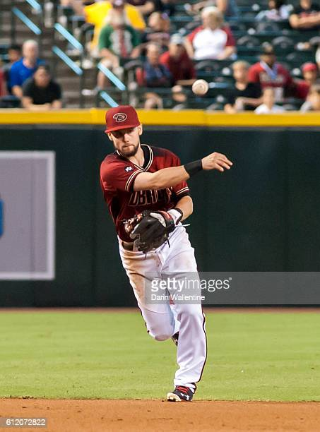 Chris Owings of the Arizona Diamondbacks fields a grounder and makes the throw in the ninth inning of the MLB game against the San Diego Padres at...