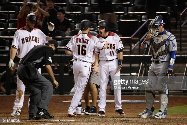 Chris Owings of the Arizona Diamondbacks is congratulated by Paul Goldschmidt and AJ Pollock after hitting a threerun home run against the Los...