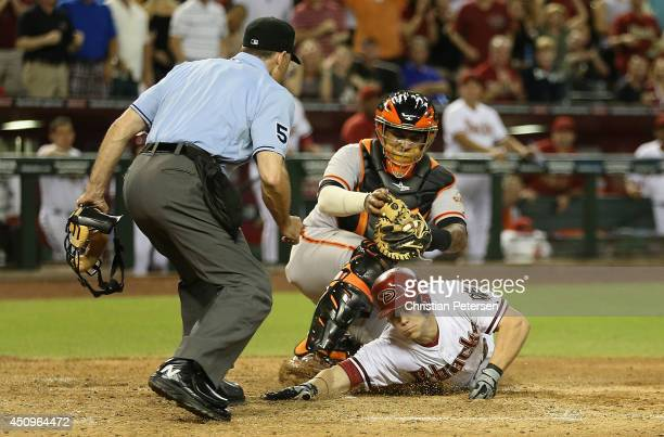 Chris Owings of the Arizona Diamondbacks is tagged out at home plate by catcher Hector Sanchez of the San Francisco Giants as Owings attempts to...