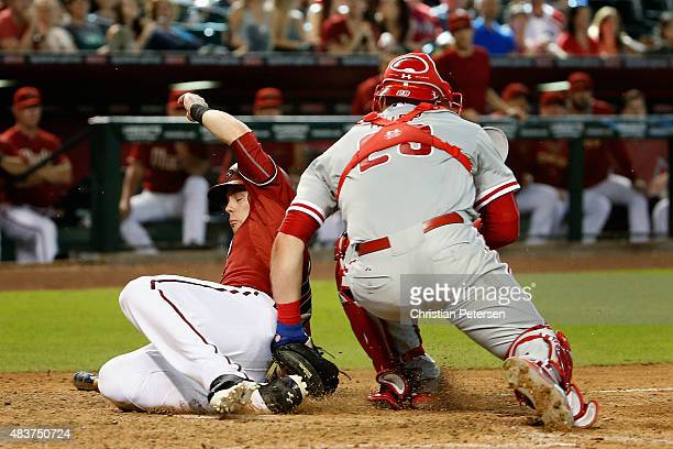 Chris Owings of the Arizona Diamondbacks is tagged out at homeplate by catcher Cameron Rupp of the Philadelphia Phillies during the eighth inning of...