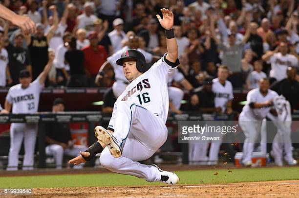 Chris Owings of the Arizona Diamondbacks safely slides into home plate to score the game winning run in the ninth inning against the Chicago Cubs at...