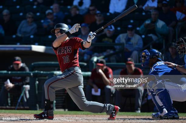 Chris Owings of the Arizona Diamondbacks singles during the sixth inning of the spring training game against the Kansas City Royals at Surprise...