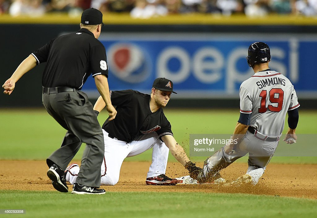 Chris Owings #16 of the Arizona Diamondbacks tags out Andrelton Simmons #19 of the Atlanta Braves at second base during the seventh inning at Chase Field on June 7, 2014 in Phoenix, Arizona.