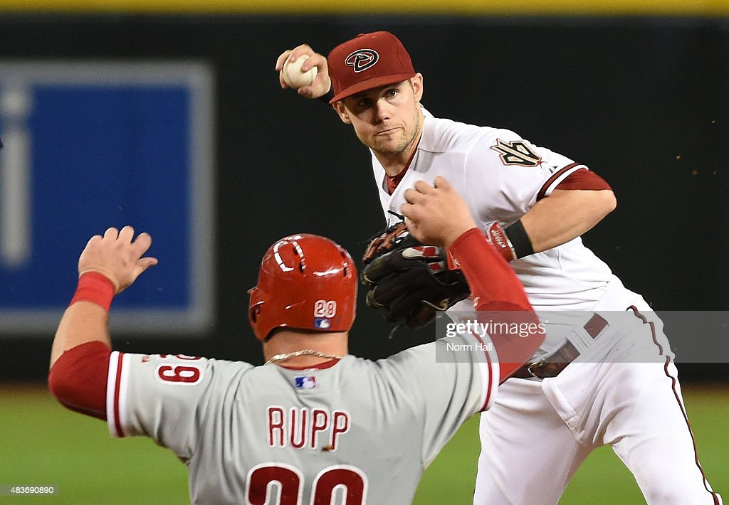 Chris Owings #16 of the Arizona Diamondbacks turns a double play as Cameron Rupp #29 of the Philadelphia Phillies slides into second base during the seventh inning at Chase Field on August 11, 2015 in Phoenix, Arizona.