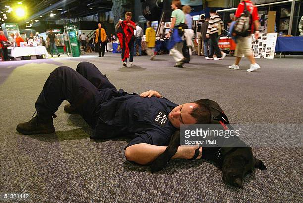 Chris Padden takes a break with Kodiak a New York search and rescue dog at the third annual Search and Rescue and Service Dog Day and Awards for...