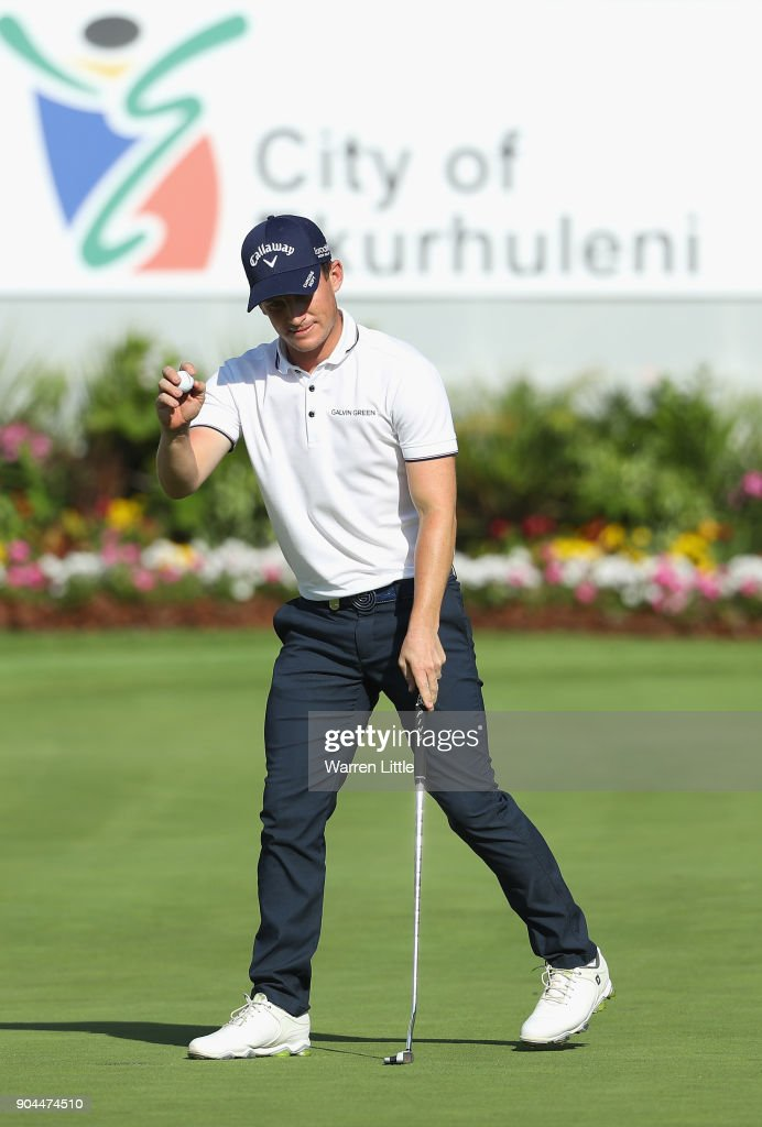 Chris Paisley of England acknowldges the crowd on the 18th green during the third round of the BMW South African Open Championship at Glendower Golf Club on January 13, 2018 in Johannesburg, South Africa.